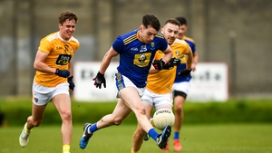 Conor Byrne of Wicklow in action against Eoin Nagle, left, and Kevin Quinn of Antrim