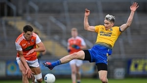 Cathal Compton of Roscommon gets to the ball ahead of Niall Grimley of Armagh