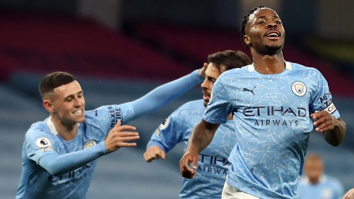 Raheem Sterling (R) celebrates what proved to be the only goal