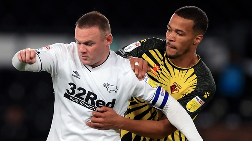 Rooney in action against Watford on Friday, one day after being visited at home by Josh Bardsley