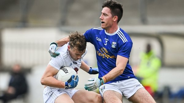 Darragh Kirwan of Kildare (l) is tackled by Cavan's Killian Brady
