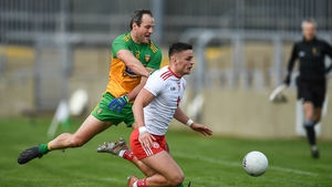 Michael McKernan of Tyrone in action against Michael Murphy of Donegal