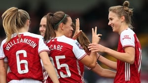 Katie McCabe and Vivianne Miedema (r) celebrate a commanding derby win
