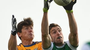 Eoin Donnelly of Fermanagh in action against Aaron Fitzgerald of Clare