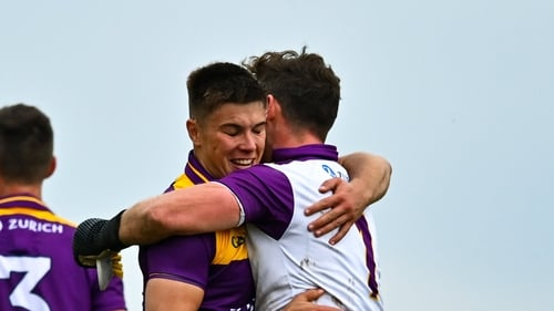 Eoin Porter celebrates with goalkeeper Pa Doyle, who made two crucial saves in the second-half