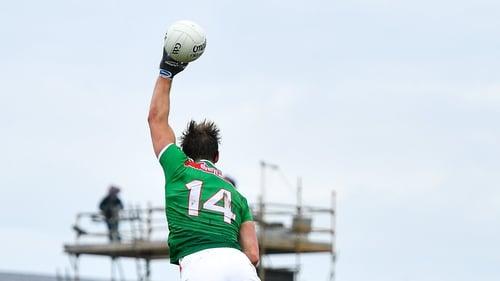 Aidan O'Shea climbs above Séan Andy Ó Ceallaigh of Galway