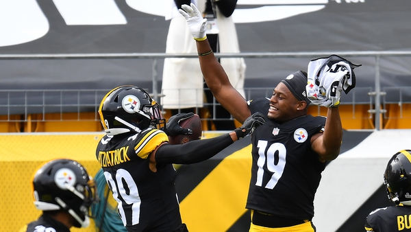 Minkah Fitzpatrick of the Steelers celebrates with JuJu Smith-Schuster after his pick-six against the Browns and an out-of-sorts Baker Mayfield
