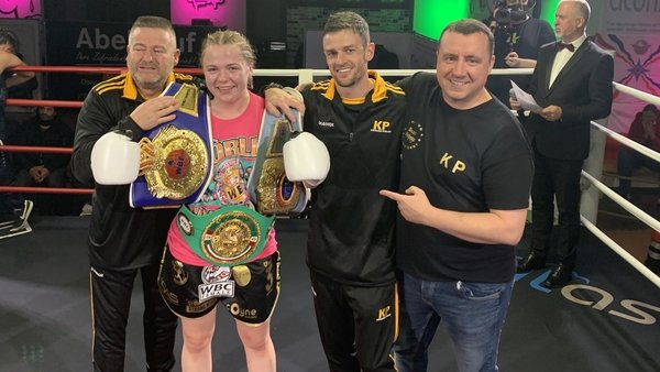 Katelynn Phelan poses with the belts following the win in Germany