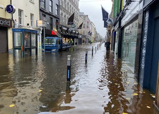 Buildings & cars damaged by flooding in Cork