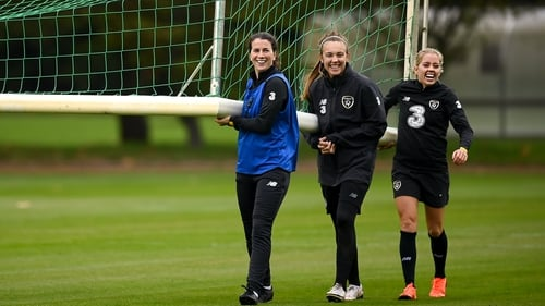 Niamh Fahey (L), Grace Moloney (C) and Denise O'Sullivan in good spirits during Ireland training