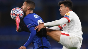 Sevilla's Marcos Acuna tackles Chelsea midfielder Hakim Ziyech