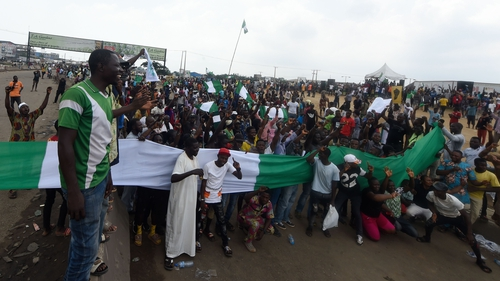 Protesters barricade the Lagos-Ibadan expressway during a demonstration to protest against police brutality at Magboro, Ogun State, Nigeria, today
