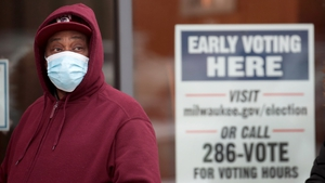 A man waits in line to vote in the Midtown neighbourhood of Milwaukee, Wisconsin