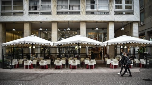 An empty restaurant in Milan, where close to 2,000 infections were recorded over the last 24 hours