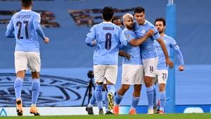 Sergio Aguero celebrates with his City team-mates following his goal