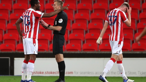 Stoke City's John Obi Mikel appeals to match referee Michael Salisbury not to send off Nathan Collins