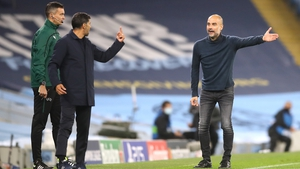 Manchester City manager Pep Guardiola (right) gestures towards FC Porto manager Sergio Conceicao on the touchline