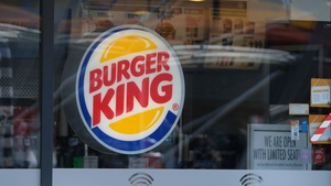 A reopening US economy and government stimulus cheques boosted spending at the company's Burger King chain