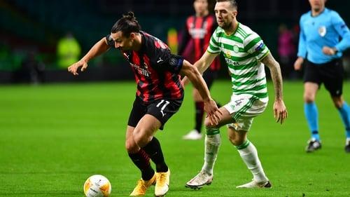 AC Milan's Zlatan Ibrahimovic looks to break past Celtic's Shane Duffy