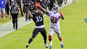 Philadelphia Eagles' Boston Scott (No 35) beats Jabrill Peppers for a touchdown reception
