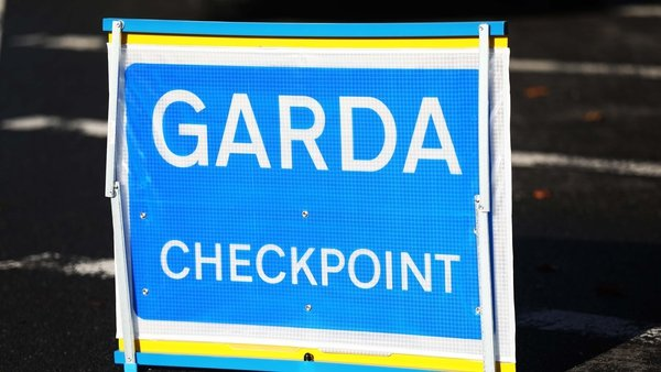 A garda Covid-19 checkpoint was in place and the car drove the wrong way around the roundabout before crashing a short time later