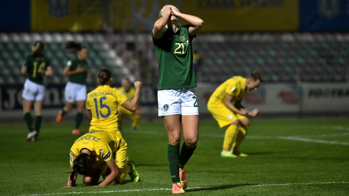 Ruesha Littlejohn holds her head in her hand at the final whistle in Kyiv