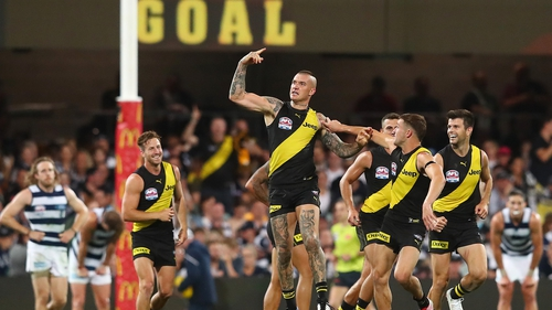 Man of the match Dustin Martin celebrates a goal for the Tigers