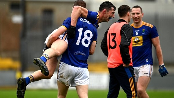Rory Finn picks up Padraig O'Toole as Wicklow celebrate their victory on enemy territory