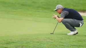 Ross McGowan lines up a putt on the 18th