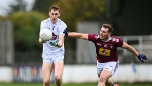 Aaron Masterson of Kildare in action against Kieran Martin of Westmeath.