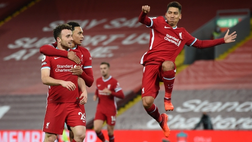 Liverpool players celebrate at Anfield