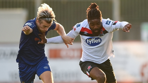 Nathan Oduwa of Dundalk and Matty Smith of Waterford battle for possession during the league game in August