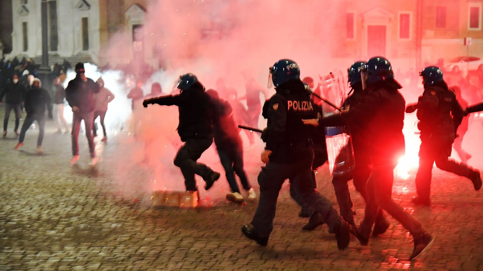 Italy protesters, police clash over virus restrictions