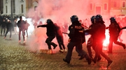 Around 200 protesters clashed with Italian riot police last night