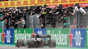Lewis Hamilton crosses the finish line to win in Portugal
