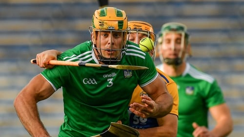 Dan Morrissey of Limerick attempts to evade his marker