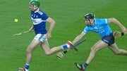 Dublin's Danny Sutcliffe trips Laois' Paddy Purcell