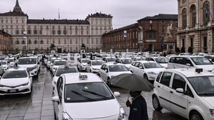 Taxis parked on Piazza Castello square in Turin during a strike to protest against Covid-19 restrictions