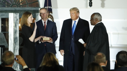 Amy Coney Barrett was sworn in by Supreme Court Justice Clarence Thomas (R)
