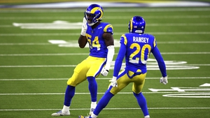 Rams Linebacker Leonard Floyd (54) looks at the Chicago Bears bench as he celebrates with cornerback Jalen Ramsey (20) after stopping the Bears during the first half at SoFi Stadium