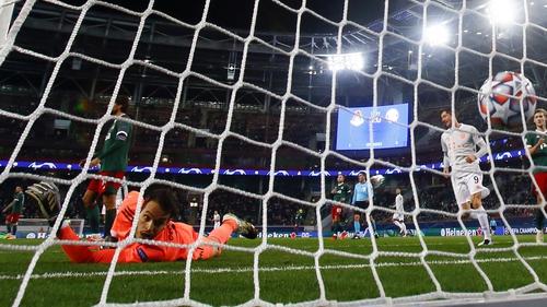 Lokomotiv Moscow's goalkeeper Guilherme is beaten by Leon Goretzka's header