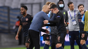 Pep Guardiola congratulates his players, including Phil Foden, after the win over Marseille