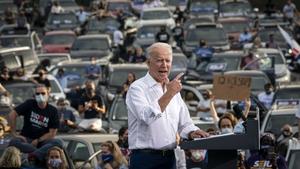 Joe Biden speaks to supporters at a drive-in rally in Atlanta, Georgia