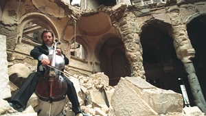 Cellist Vedran Smailovic plays Strauss in the bombed National Library in Sarajevo on September 2 1992
