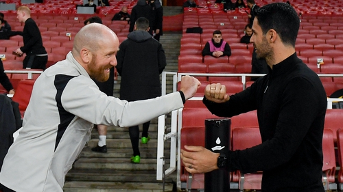 Dundalk opposition analyst Shane Keegan (L) bumps fists with Mikel Arteta