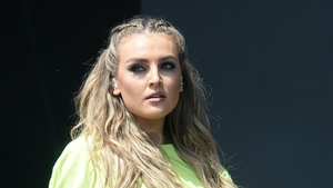 Perrie Edwards has revealed she is suffering with back pain
