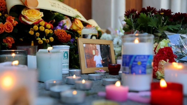 Candles are lit in front of the Notre-Dame de l'Assomption Basilica in Nice in memory of those who died