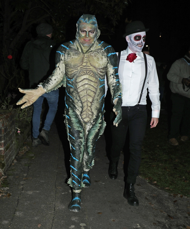 Alan Carr (left) and his husband Paul Drayton leaving a Halloween party hosted by Jonathan Ross