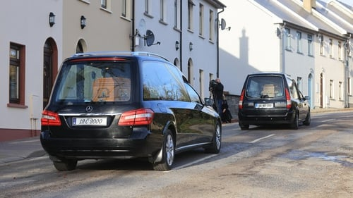 The coffins bearing the two men were taken by hearse to St Bridget's Cemetery for burial