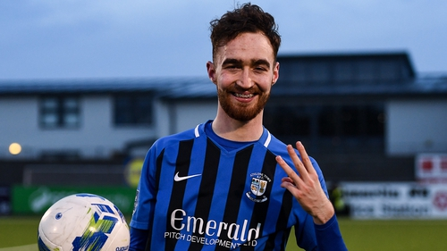 Dean George with the match ball after his hat-trick against Shelbourne